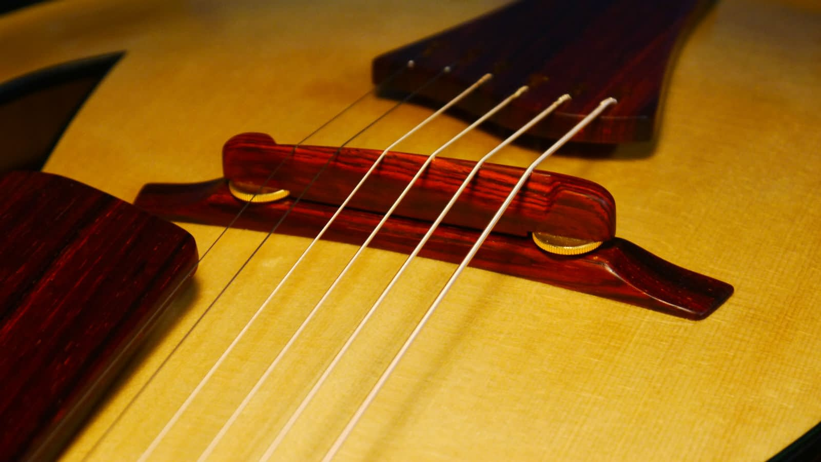 handmade adjsutable archtop guitar bridge cocobolo brass wheels