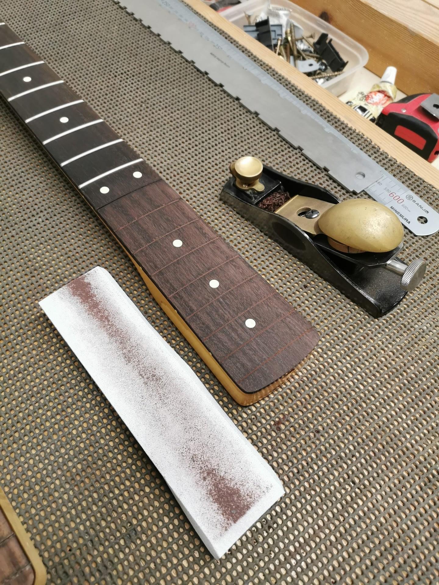 Fender Bass Neck Fretboard leveling guitar repair stroud